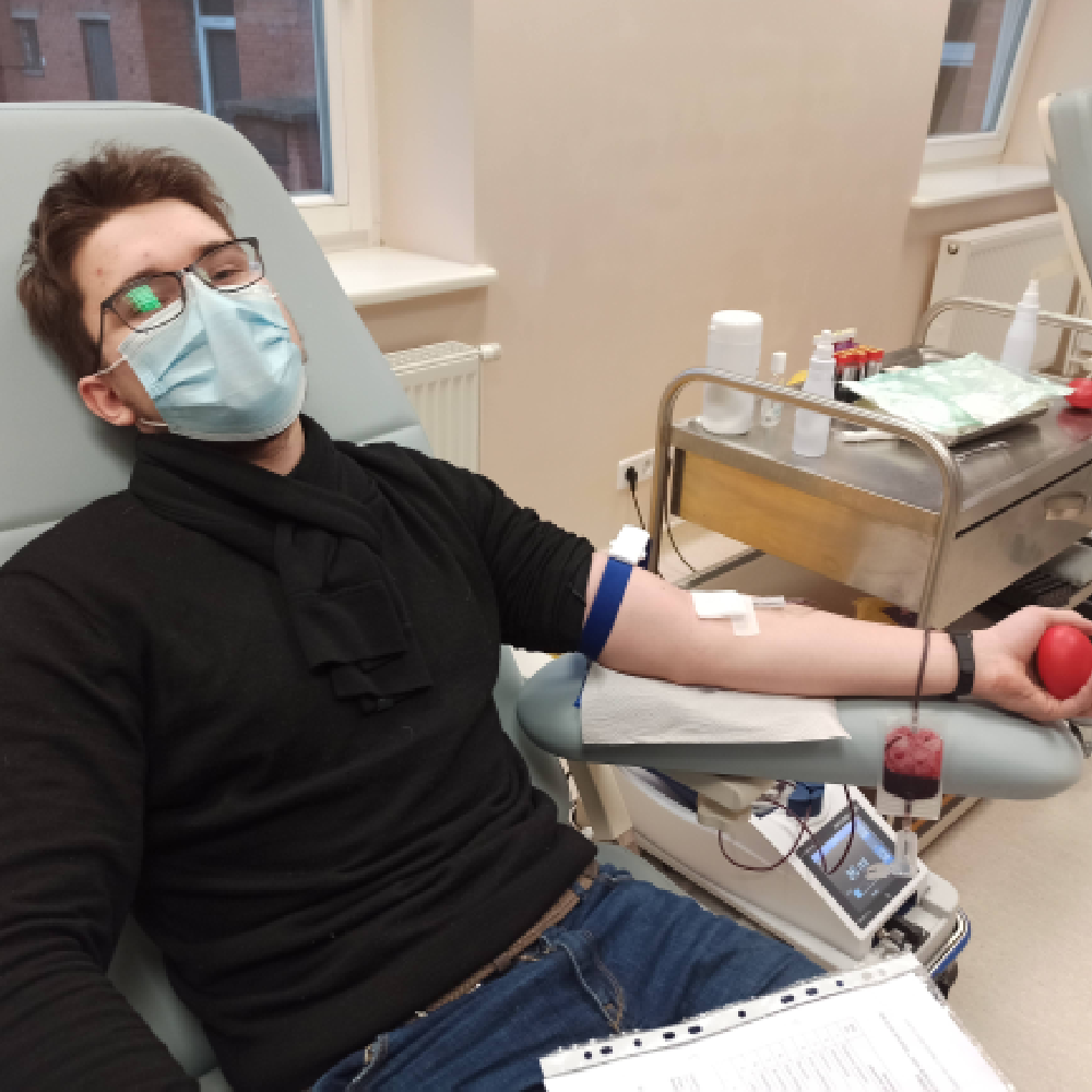 Arnas donating his blood for the first time